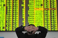 Asian shares wobble, on track for monthly loss