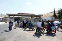 World: Rebel says Aleppo due to get aid Friday, but has little hope it will