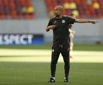 Soccer-Guardiola says impressed by Hart, Toure despite transfer rumours