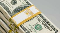 Rupee reaches two and a half year low closing at 64.79 to US dollar