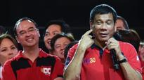 Philippine president backs autonomy law on Muslim south