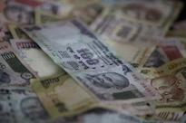 Rupee near one-week high; foreign fund flows watched