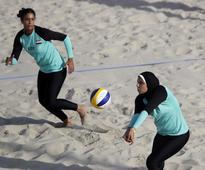 Why do women volleyball players wear bikinis?