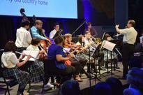 Fukushima pupils perform with NY Phil musici...