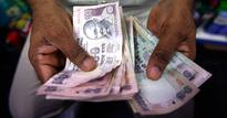 Rupee up 13 paise to 61.62 against dollar in early trade