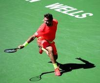 Djokovic gains revenge, Nadal rallies to advance