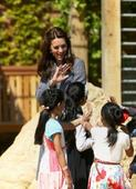 Duchess and the dragon: Kate charms children at Hampton Court Palace