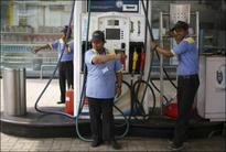 Oil refiners rise on petrol price hike