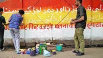 Artists reclaim DJB wall in Shahdara with Urdu couplet