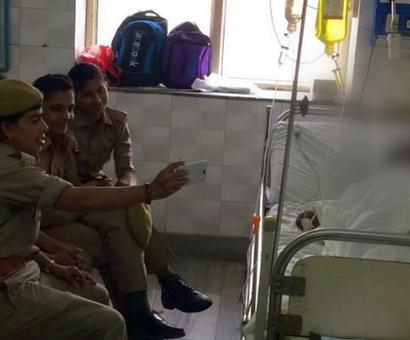 UP: 3 women cops suspended after taking selfies with acid attack victim