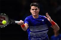 Raonic hits 17 aces to reach third round