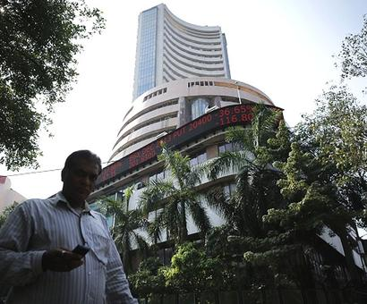 Sensex breaches 22,000 level, then retreats