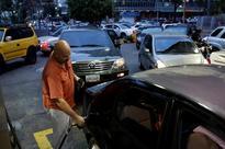 Venezuelans line up for gasoline as OPEC nation's oil industry struggles