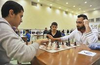 Qatargas Chess Championship kicks off International Master Nezad Husein Aziz (right) of Qatar shows some moves to ...