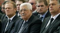 Abbas pardons officer who criticized him for attending Peres funeral