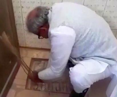 BJP MP cleans up clogged toilet at village primary school