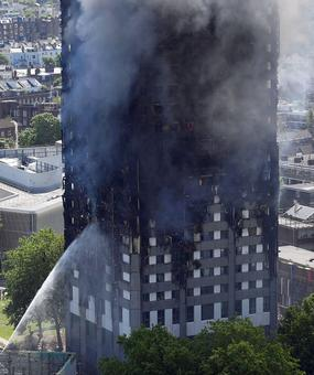 Death toll in London inferno hits 30, and is likely to climb to over 100