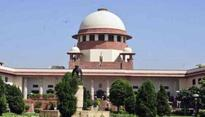 SC seeks Guj's reply on plea over re-induction of 2 cops