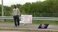 Man stands outside Gillette Stadium waiting for Patriots tryout