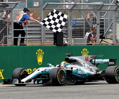 Hamilton wins British Grand Prix to slash Vettel's lead