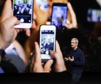 Apple quarterly profit off 19% as iPhone sales slip but Cook upbeat