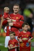 Coleen cheers for Rooney as sons join him on pitch