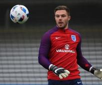 Butland 'pain free' after return