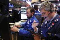 Strong earnings, surge in oil power Dow to record high