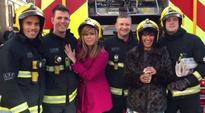 Is it getting hot in here? Kate Garraway playfully poses with firemen that put out ITV blaze
