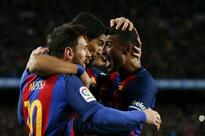 Free kick specialist Messi fires Barca into cup last eight