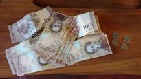 Newest headache for Venezuelans: Accessing and carrying loads of worthless cash