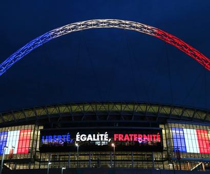 PHOTOS: At soccer match with France, British PM to lead show of solidarity