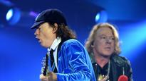 Is Angus Young working on new AC/DC album featuring Axl Rose?