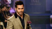 It's a rumour: Varun Dhawan on working with Big B