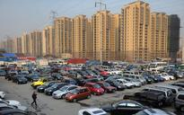 China's March home prices defy curbs, further tightening expected