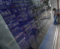Asia shares near record peak but trade protectionist fears cast shadow