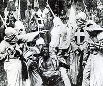 Growing Venezuela lynch mobs burn thieves aliv... A scene from the 1915 movie, The Birth of a Nation, showing African-American...