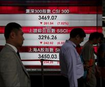 Asian shares muted as tech blues offset US tax cut optimism