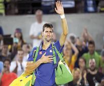 Djokovic hit by double trouble