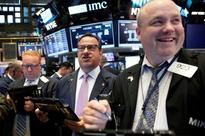 Wall St. gains as data points to budding economy
