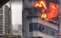 Man in China dodges death after high-rise in Chongqing city catches fire | WATCH