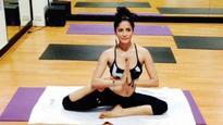 Female yoga teacher says 'hot yoga' guru Bikram asked her to massage his private parts