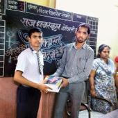 Collegians distribute study kits to Std X students affected by Damu Nagar fire
