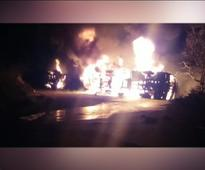 Driver dies as two trucks catch fire after head-on collision