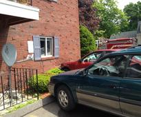 Driver crashes into her apartment building