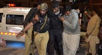 Gunmen detonate explosive vests to kill at least 50 and injure more than 100 at police training centre