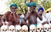 Protesting Tamil Nadu farmer's weapons: Skull, rope, rat, snake, black cloth, meditation