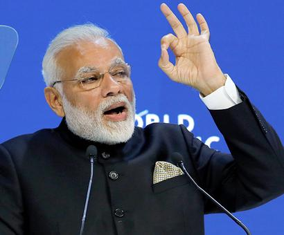 China praises Modi for opposing protectionism in Davos address