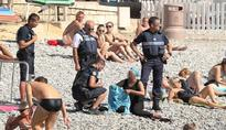 French court overturns burkini ban after staged controversy over forced beach burkini removal