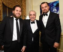 Leonardo DiCaprio and Jonah Hill can't stop giggling as they reunite with Wolf Of Wall Street director Martin Scorsese